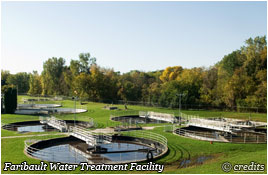 Faribault Water Treatment facility with trees in the background