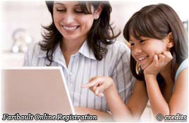 A mother and daughter using a computer for Faribault online registration
