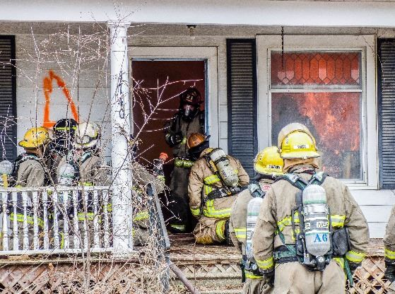 Fire Fighters enter house