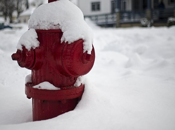 An image of a snow-covered fire hydrant