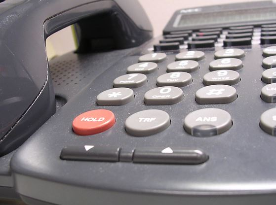 An image of an office phone on a desk.